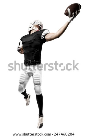 Football Player with a black uniform making a catching on a white background.