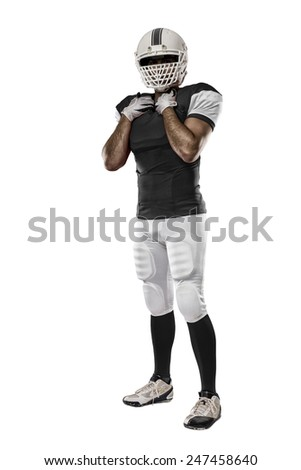 Football Player with a Black uniform on a white background. - stock photo