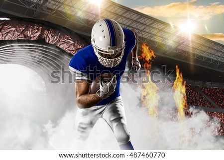 Football Player with a blue uniform coming out of a stadium tunnel.