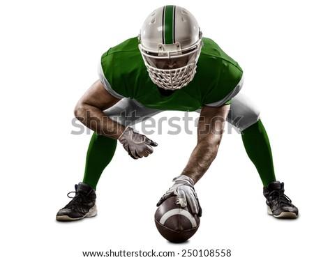 Football Player with a Green uniform on the scrimmage line, on a white background. - stock photo