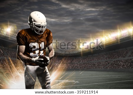 Football Player with a orange uniform on a stadium.