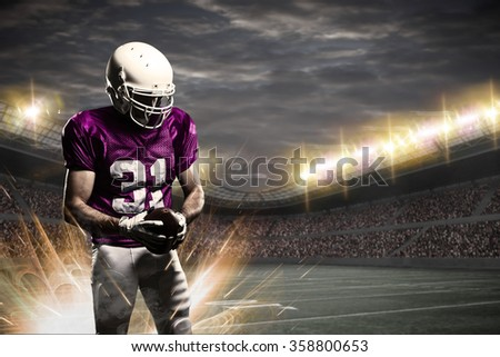 Football Player with a pink uniform on a stadium.