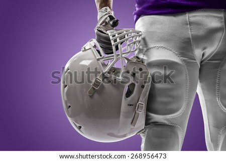 Football Player with a purple uniform on a purple background.