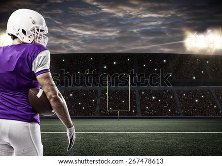 Football Player with a purple uniform on a stadium.