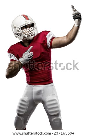 Football Player with a red uniform making a selfie on a white background.