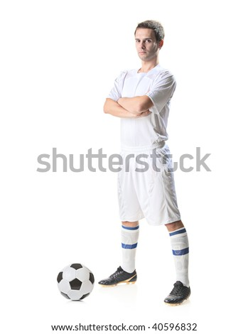 Football player with a soccer ball isolated against white background - stock photo