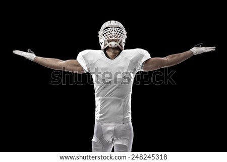 Football Player with a white uniform celebrating, on a black background. - stock photo