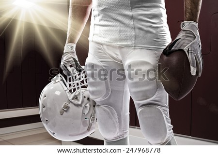 Football Player with a white uniform on a Locker roon. - stock photo