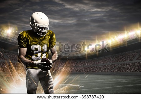 Football Player with a yellow uniform on a stadium.