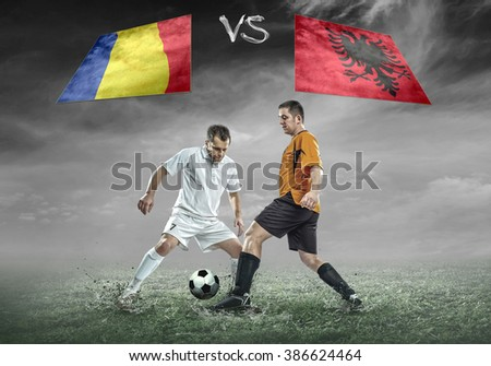Football player with ball in action under sky with clouds. Soccer match between two countries. - stock photo