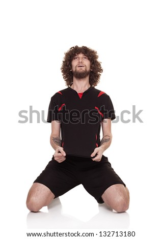 football player with crisp hair and black uniform celebrating the score isolated on white - stock photo