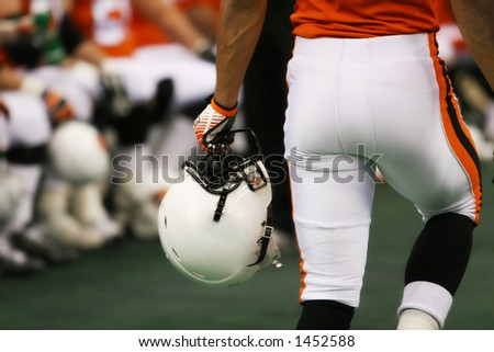 football player with helmet  closeup - stock photo