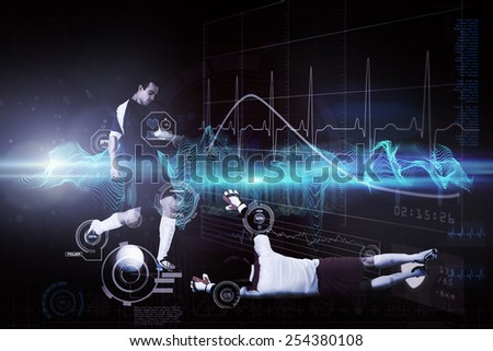 Football players tackling for the ball against abstract blue glowing black background - stock photo