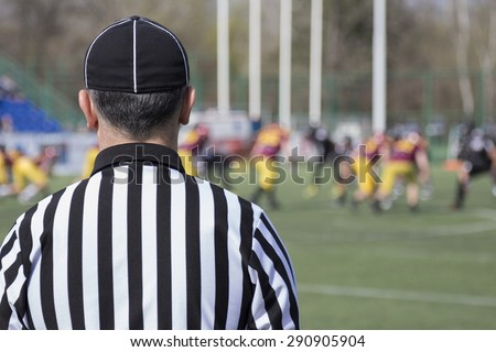 Football referee observing the match
