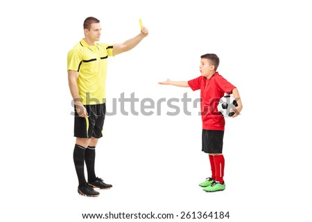 Football referee showing yellow card to a junior soccer player isolated on white background - stock photo