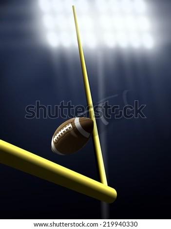 Football Score Kick Under Spotlight - stock photo
