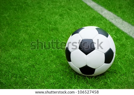 football, soccer ball on pitch - stock photo