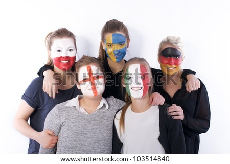 Football soccer fans together, smiling, having fun - stock photo