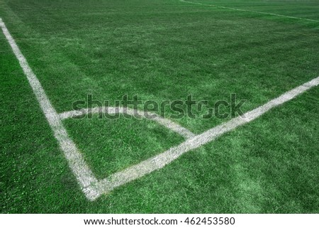 Football soccer field corner with white marks, green grass texture.