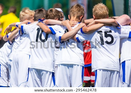 Football; soccer; handball; volleyball; match for children. shout team, football soccer game. Team work and unity. Time break.  - stock photo