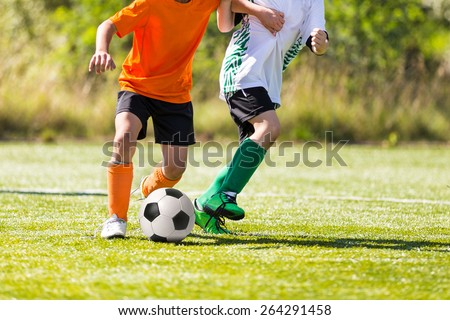 Football soccer match. Training and game for children. - stock photo