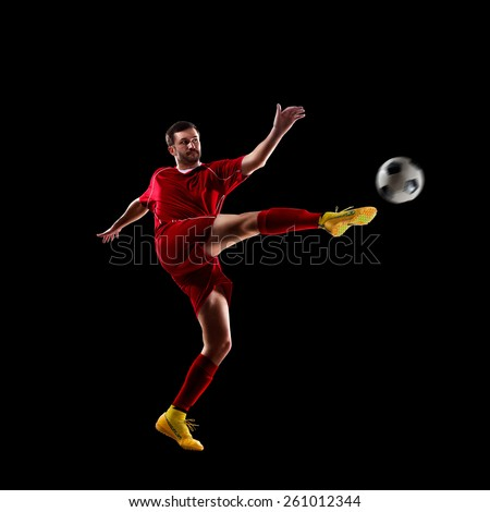 football soccer player in action  isolated on black background - stock photo