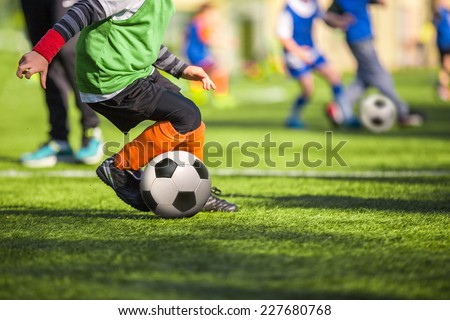 Football soccer training match for children - stock photo