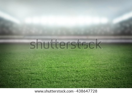 Football stadium in light of spotlights - stock photo