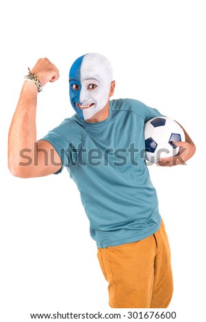 Football supporter with painted face with ball - stock photo