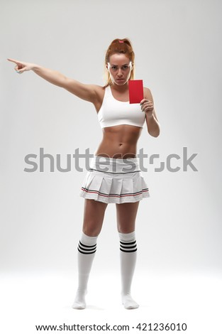 Football supporter with red card on white background - stock photo