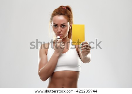 Football supporter with yellow card on white background - stock photo