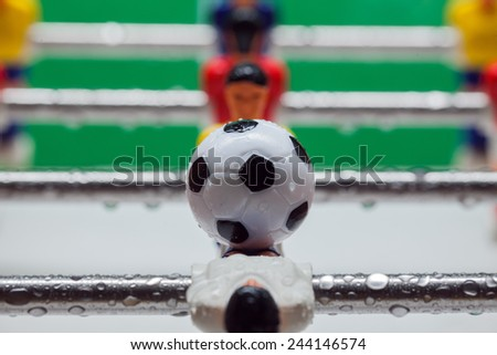 football table. football table. red and yellow players. - stock photo