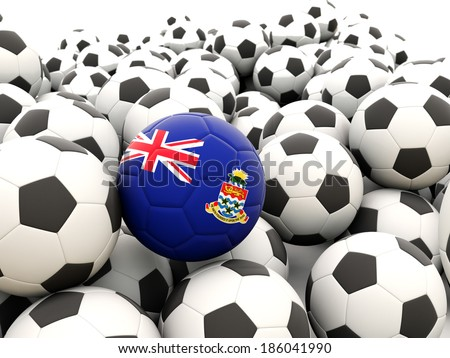 Football with flag of cayman islands in front of regular balls - stock photo