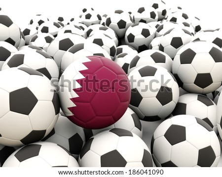 Football with flag of qatar in front of regular balls - stock photo