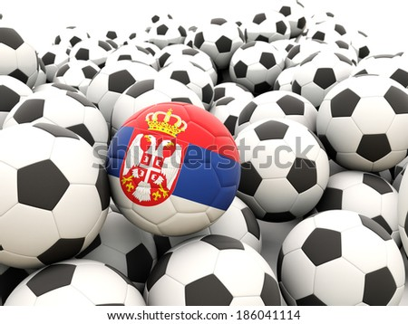 Football with flag of serbia in front of regular balls - stock photo
