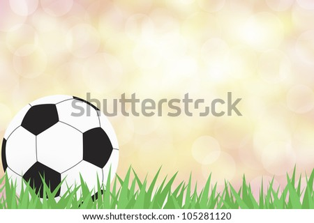 Football with green grass on color abstract  background