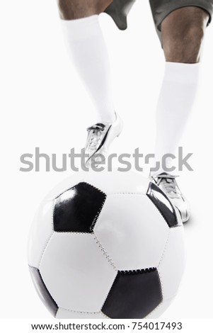 Footballer getting ready to kick a soccer ball