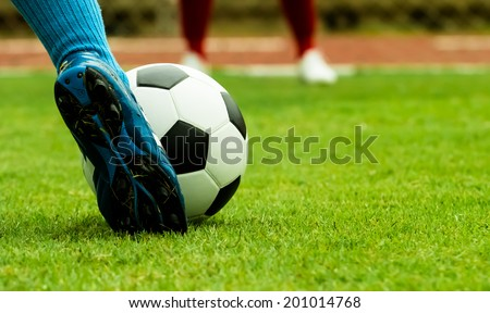 footballer Penalty shooting on grass in game - stock photo