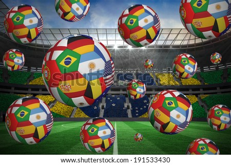 Footballs in international flags against large football stadium with brasilian fans - stock photo