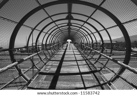 Footbridge over highway with arcs - stock photo