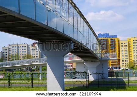 Footbridge over the street in the city - stock photo