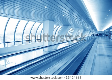 footbridge with moving path - stock photo