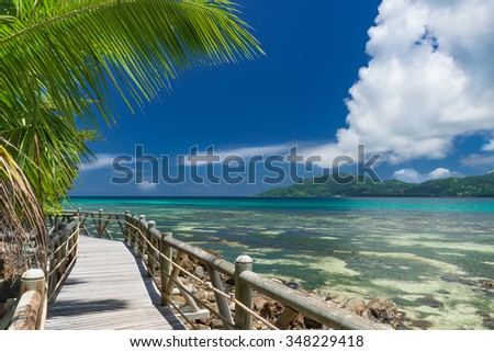 footpath along a beautiful beach on the Seychelles - stock photo