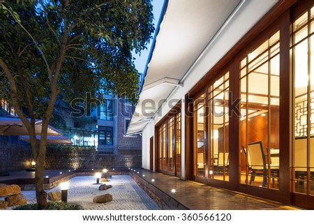 footpath front of modern building at night - stock photo