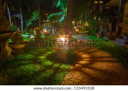 footpath in a hotel in Vietnam in light of lanterns - stock photo