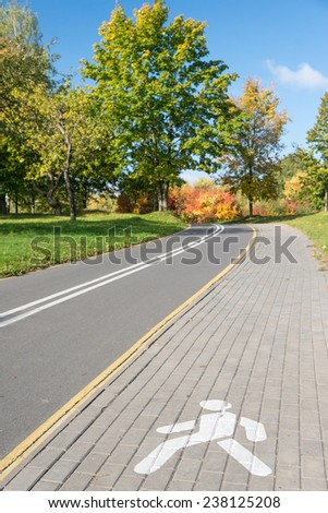 Footpath in autumn park - stock photo