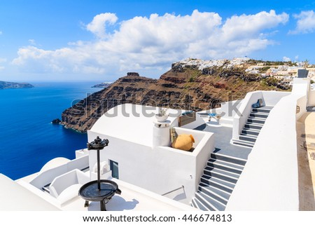 Footpath in Firostefani village with view of caldera and sea, Santorini island, Greece