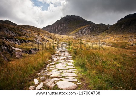 Footpath in Snowdonia National Park in Wales along to Glyder Fawr mountain - stock photo