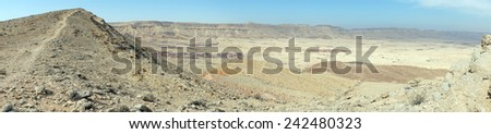 Footpath on the mount Karbolet and crater in Negev desert in Israel