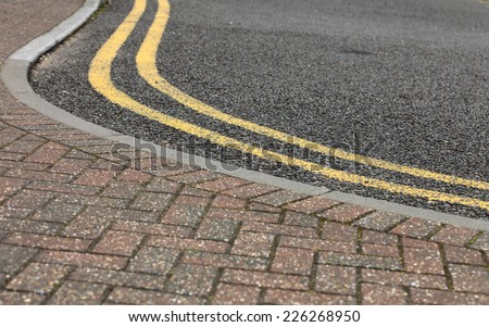 footpath pavement sidewalk and road with traffic sign - stock photo